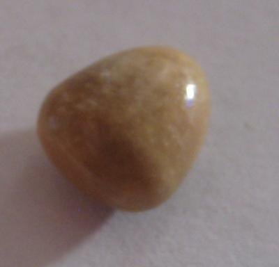 4.6 carat brown triangle conch pearl