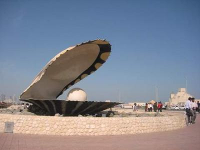 Qatar Pearl Monument (Museum seen in background) Photo by Kari