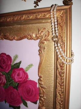 antique pearls and roses in antique frame