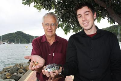 Jeweller Murray Brereton, left, and stepson and shop manager Tomas Quinn-Walshe with paua where blue pearls are formed, and a piece of jewellery.<BR>Photo: http://www.stuff.co.nz