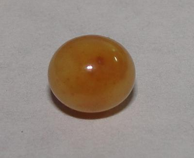 Brown Conch Pearl 2 carats Near Round