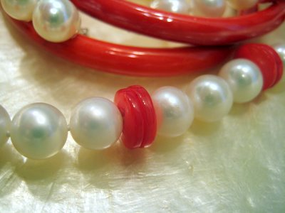 Closeup White Pearls Red Buttons