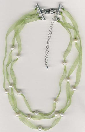 green ribbon and pearl necklace