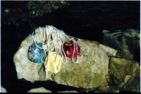 Pearls on rock with silky bags by Mississippi river