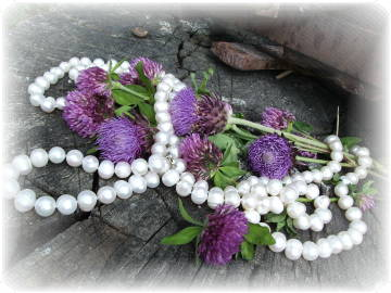 white pearls and purple flowers