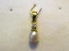 Natural Oval Basra Pearl Pendant with Diamond on 18k Gold