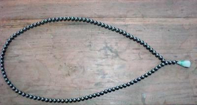 Unique Knotted Pearl Necklace