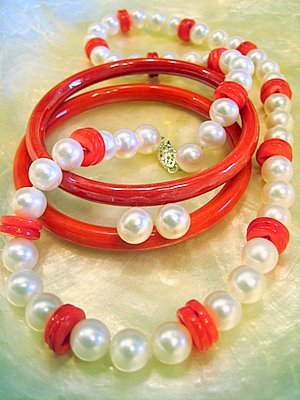 White pearls with red buttons