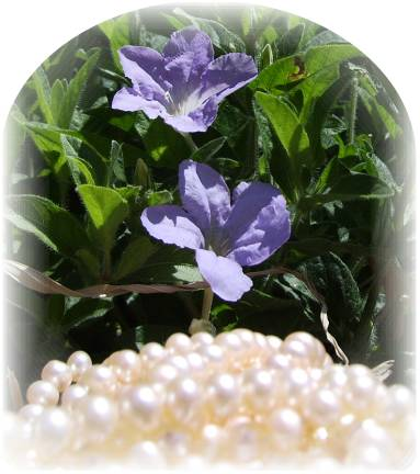 white pearls with periwinkle colored flowers