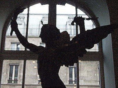 Winged Beauty by Window in Louvre