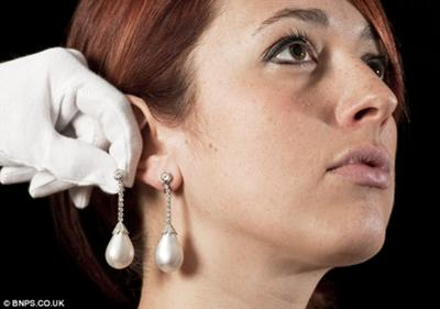 £250,000 per ear: Jewellery expert Marielle Whiting with the unique pearls that lay in a drawer for 35 years