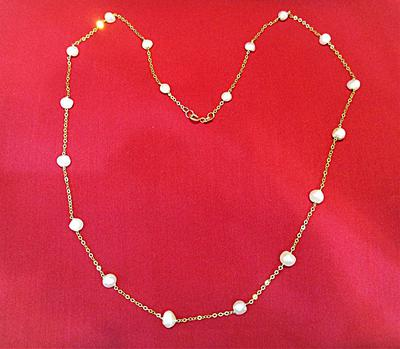 Natural Pearls Necklace on 21 karat Gold