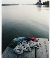 Pearls and silky bags on Mississippi River