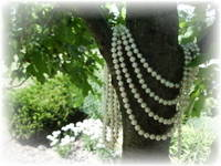 White pearls four strands on tree